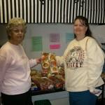 Volunteers help distribute bread