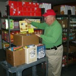 Volunteer loads family boxes