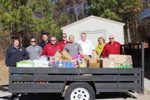 Members of Fuquay  Varina Fire Department deliver an unload food at the pantry.